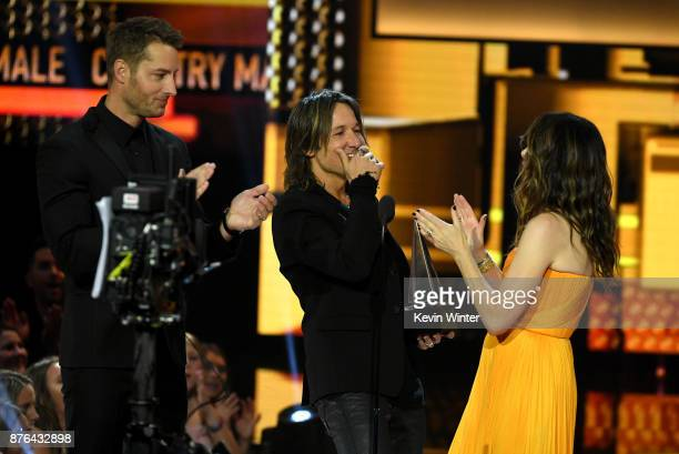 Justin Hartley and Kathryn Hahn present the Favorite Male Artist – Country award Favorite Album – Country award for 'Ripcord' and Favorite Song –...
