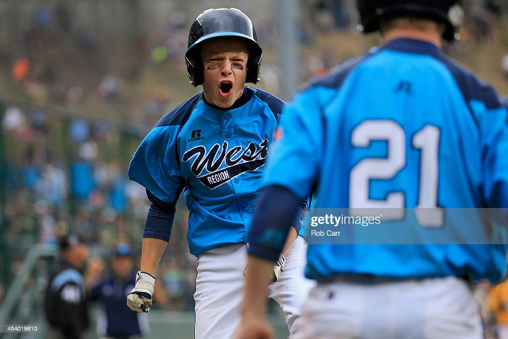 Justin Hausner #5 of the West Team from Las Vegas, Nevada celebrates after scoring a first inning run against the Great Lakes Team from Chicago, Illinois during the United States Championship game of the Little League World Series at Lamade Stadium on August 23, 2014 in South Williamsport, Pennsylvania.