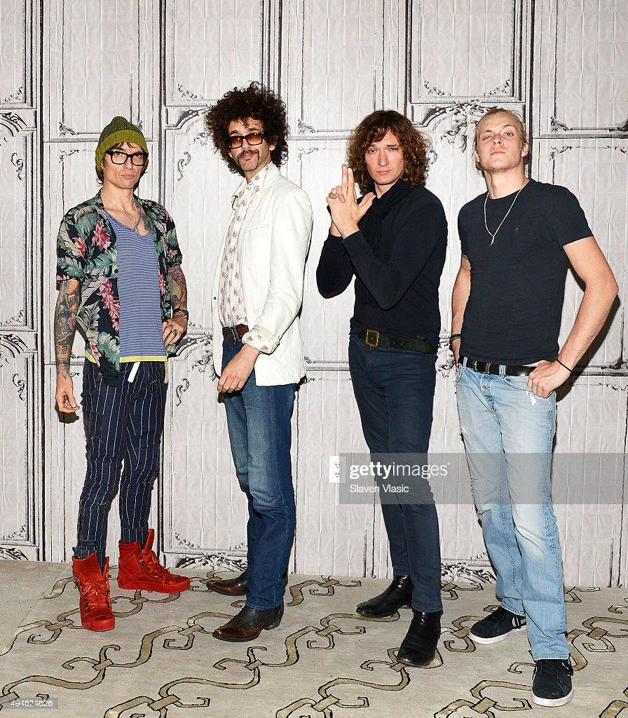 <a gi-track='captionPersonalityLinkClicked' href=/galleries/search?phrase=Justin+Hawkins&family=editorial&specificpeople=171558 ng-click='$event.stopPropagation()'>Justin Hawkins</a>, <a gi-track='captionPersonalityLinkClicked' href=/galleries/search?phrase=Frankie+Poullain&family=editorial&specificpeople=210885 ng-click='$event.stopPropagation()'>Frankie Poullain</a>, <a gi-track='captionPersonalityLinkClicked' href=/galleries/search?phrase=Dan+Hawkins+-+Musicien&family=editorial&specificpeople=213502 ng-click='$event.stopPropagation()'>Dan Hawkins</a> and Rufus Taylor of the band '<a gi-track='captionPersonalityLinkClicked' href=/galleries/search?phrase=The+Darkness&family=editorial&specificpeople=206457 ng-click='$event.stopPropagation()'>The Darkness</a>' visit AOL BUILD to discuss their new album 'Last Of Our Kind' at AOL Studios In New York on October 27, 2015 in New York City.