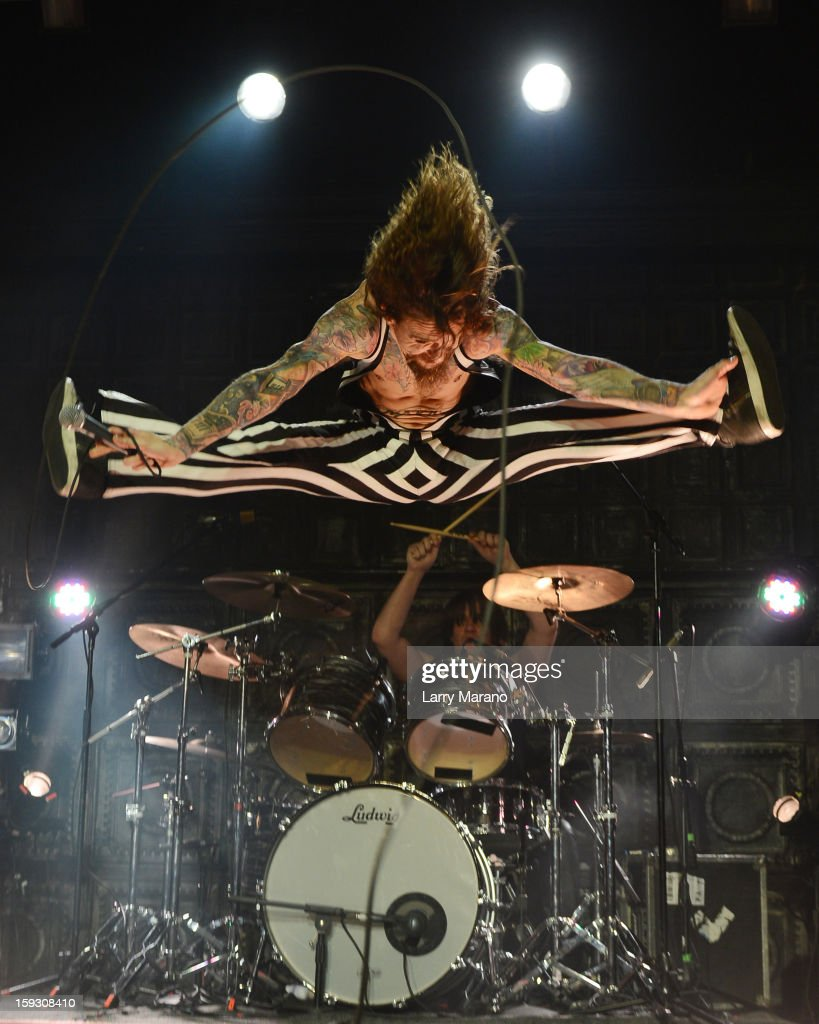 <a gi-track='captionPersonalityLinkClicked' href=/galleries/search?phrase=Justin+Hawkins&family=editorial&specificpeople=171558 ng-click='$event.stopPropagation()'>Justin Hawkins</a> of The Darkness performs at Revolution on January 10, 2013 in Fort Lauderdale, Florida.