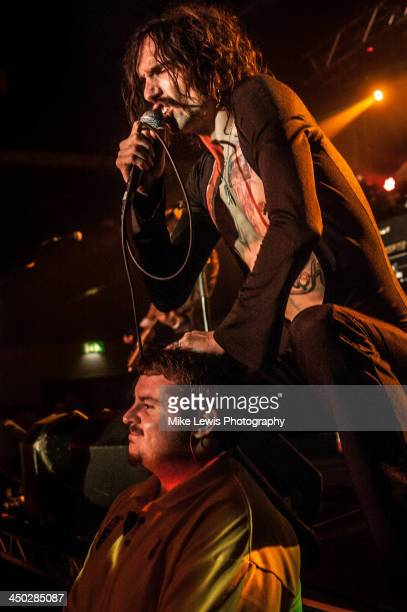 Justin Hawkins of The Darkness performs live on stage at Motorpoint Arena on November 17 2013 in Cardiff United Kingdom