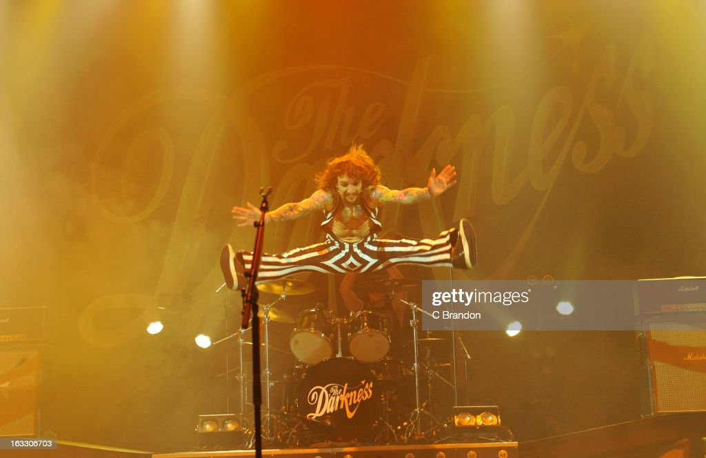 <a gi-track='captionPersonalityLinkClicked' href=/galleries/search?phrase=Justin+Hawkins&family=editorial&specificpeople=171558 ng-click='$event.stopPropagation()'>Justin Hawkins</a> of The Darkness performs on stage at Hammersmith Apollo on March 7, 2013 in London, England.