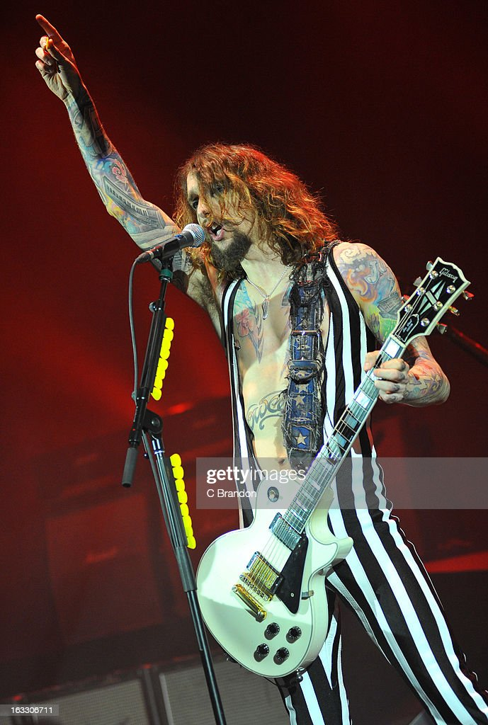 Justin Hawkins of The Darkness performs on stage at Hammersmith Apollo on March 7, 2013 in London, England.