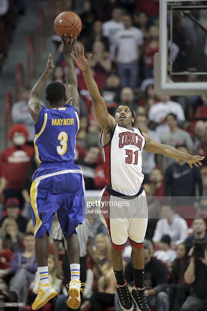 <a gi-track='captionPersonalityLinkClicked' href=/galleries/search?phrase=Justin+Hawkins&family=editorial&specificpeople=171558 ng-click='$event.stopPropagation()'>Justin Hawkins</a> #31 of the UNLV Rebels attempts to block a shot attempt against Javonte Maynor #3 of the CSU Bakersfield Roadrunners at the Thomas & Mack Center on January 5, 2013 in Las Vegas, Nevada.
