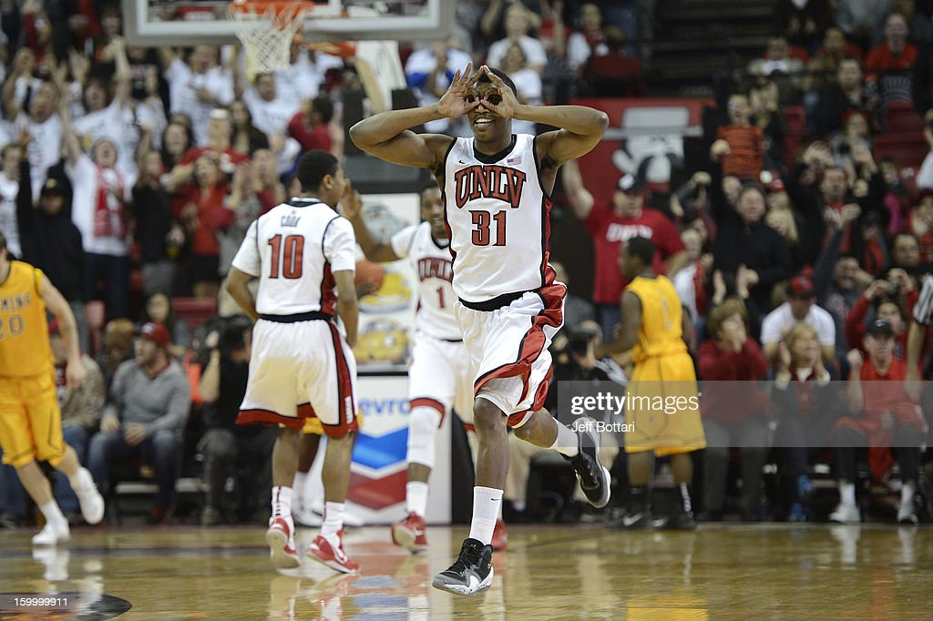 <a gi-track='captionPersonalityLinkClicked' href=/galleries/search?phrase=Justin+Hawkins&family=editorial&specificpeople=171558 ng-click='$event.stopPropagation()'>Justin Hawkins</a> #31 of the UNLV Rebels celebrates after a teammate makes a 3-pointer against the Wyoming Cowboys at the Thomas & Mack Center January 24, 2013 in Las Vegas, Nevada.
