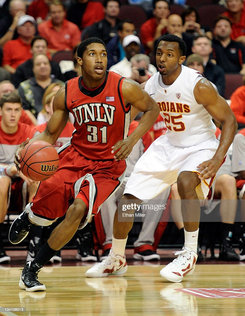 <a gi-track='captionPersonalityLinkClicked' href=/galleries/search?phrase=Justin+Hawkins&family=editorial&specificpeople=171558 ng-click='$event.stopPropagation()'>Justin Hawkins</a> #31 of the UNLV Rebels drives around Byron Wesley #25 of the USC Trojans during the third round of the Continental Tire Las Vegas Invitational at the Orleans Arena November 25, 2011 in Las Vegas, Nevada. UNLV won 66-55.