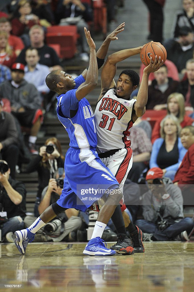 Justin Hawkins #31 of the UNLV Rebels looks to pass the ball against Michael Lyons #14 of the Air Force Falcons at the Thomas & Mack Center on January 12, 2013 in Las Vegas, Nevada. The Rebels won 76-71.