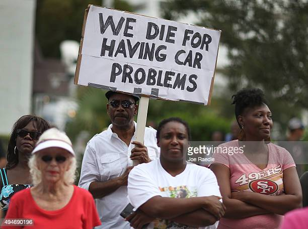 Justin Hepburn holds a sign reading 'We die for having car problems' as he attends a rally for Corey Jones in front of the State Attorney's office...