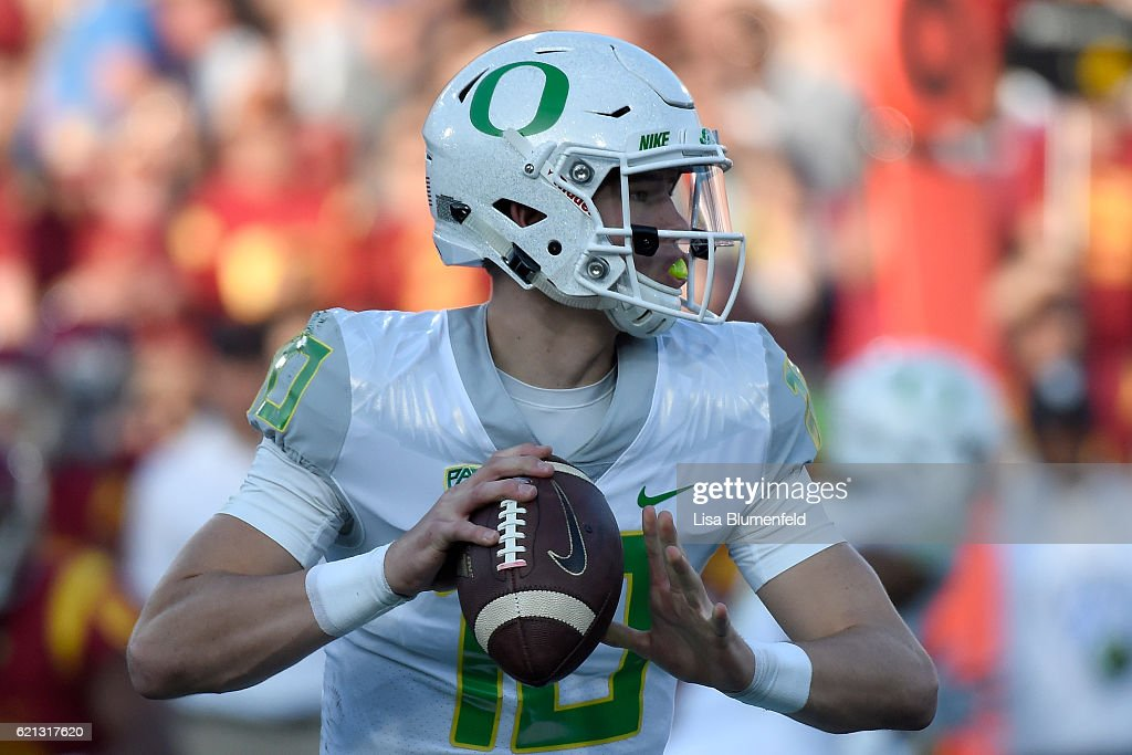 Justin Herbert #10 of the Oregon Ducks looks to pass in the first quarter against the USC Trojans at Los Angeles Memorial Coliseum on November 5, 2016 in Los Angeles, California.