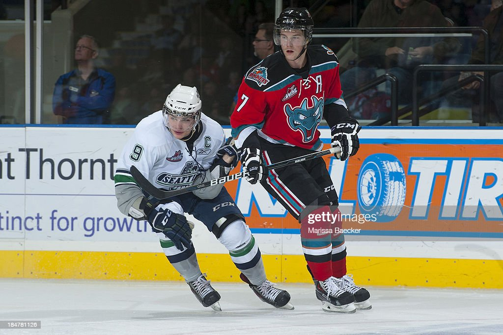 Justin Hickman #9 of the Seattle Thunderbirds checks Damon Severson #7 of the Kelowna Rockets on October 11, 2013 at Prospera Place in Kelowna, British Columbia, Canada