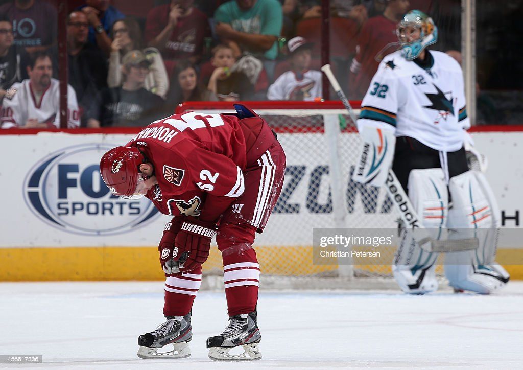 Justin Hodgeman #52 of the Arizona Coyotes skates off the ice after an injury during the third period of the preseason NHL game against the San Jose Sharks at Gila River Arena on October 3, 2014 in Glendale, Arizona. The Sharks defeated the Coyotes 3-1.