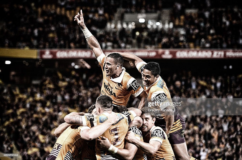 Justin Hodges of the Broncos and team mates celebrate a try by Jack Reed during the NRL First Preliminary Final match between the Brisbane Broncos and the Sydney Roosters at Suncorp Stadium on September 25, 2015 in Brisbane, Australia.
