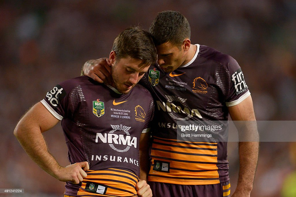 Justin Hodges of the Broncos reacts with Ben Hunt of the Broncos after defeat during the 2015 NRL Grand Final match between the Brisbane Broncos and the North Queensland Cowboys at ANZ Stadium on October 4, 2015 in Sydney, Australia.