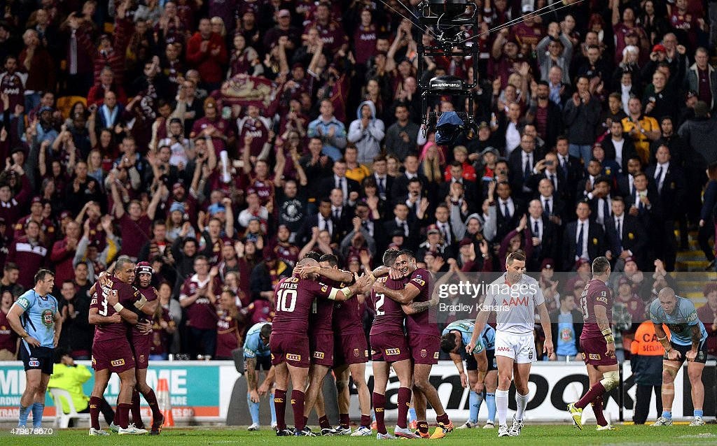 Justin Hodges of the Maroons and team mates celebrate victory as the full time siren sounds after game three of the State of Origin series between...