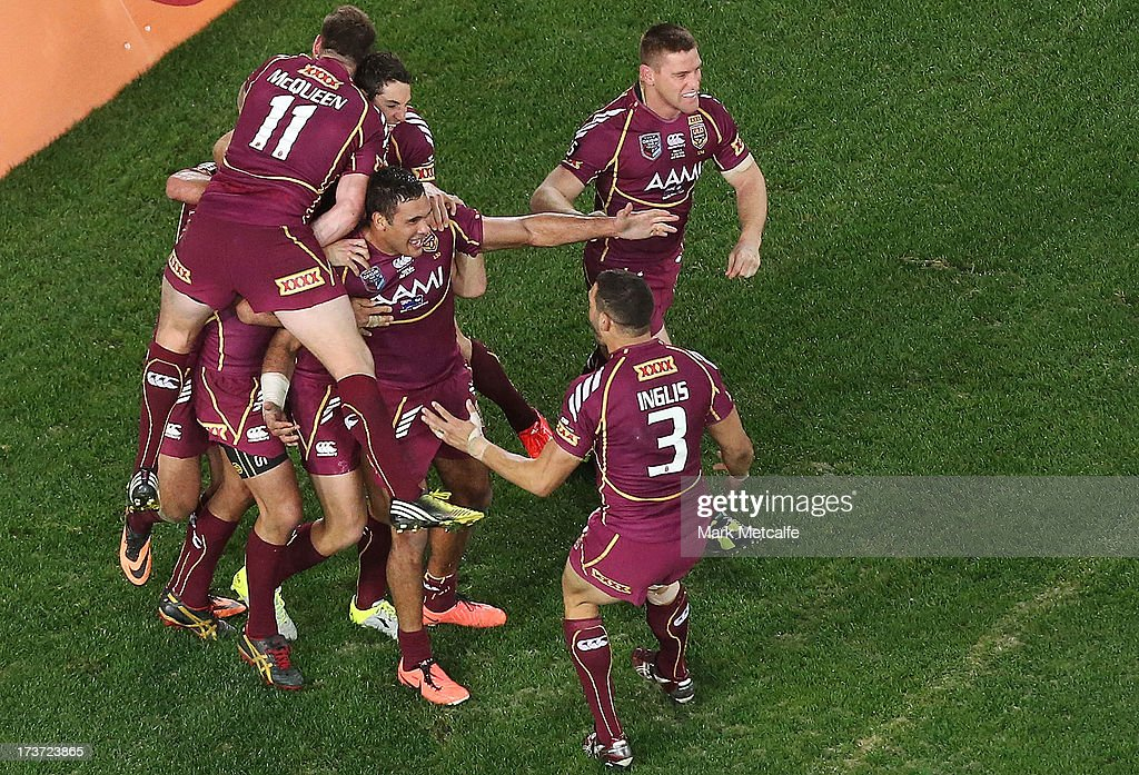 Justin Hodges of the Maroons celebrates with teammates after scoring a try during game three of the ARL State of Origin series between the New South Wales Blues and the Queensland Maroons at ANZ Stadium on July 17, 2013 in Sydney, Australia.