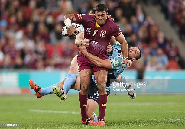 Justin Hodges of the Maroons is tackled by Josh Morris and Greg Bird of the Blues during game three of the State of Origin series between the...