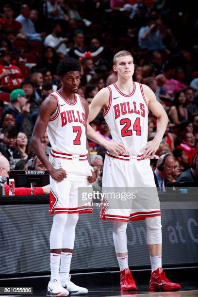 Justin Holiday and Lauri Markkanen of the Chicago Bulls look on during the game against the Toronto Raptors on October 13 2017 at the United Center...