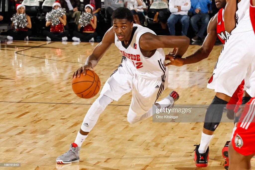 Justin Holiday #12 drives the ball against the Maine Red Claws during the NBA D-League game on December 26, 2012 at CenturyLink Arena in Boise, Idaho.