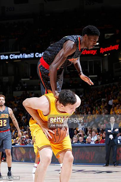 Justin Holiday of the Atlanta Hawks goes over the back of Sasha Kaun of the Cleveland Cavaliers in the first half of a preseason game at Cintas...