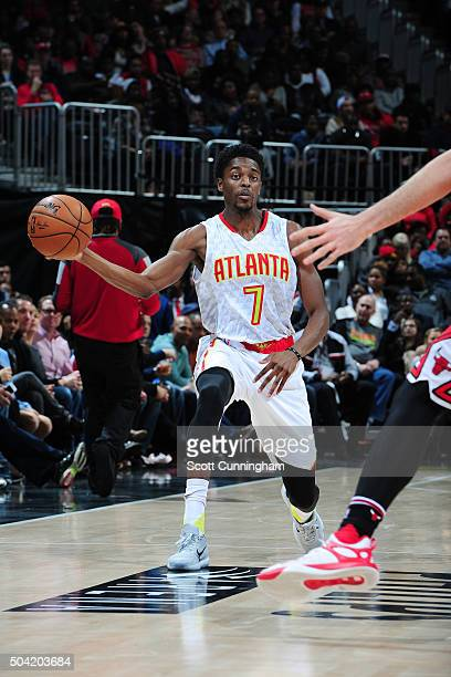 Justin Holiday of the Atlanta Hawks handles the ball during the game against the Chicago Bulls on January 9 2016 at Philips Center in Atlanta Georgia...