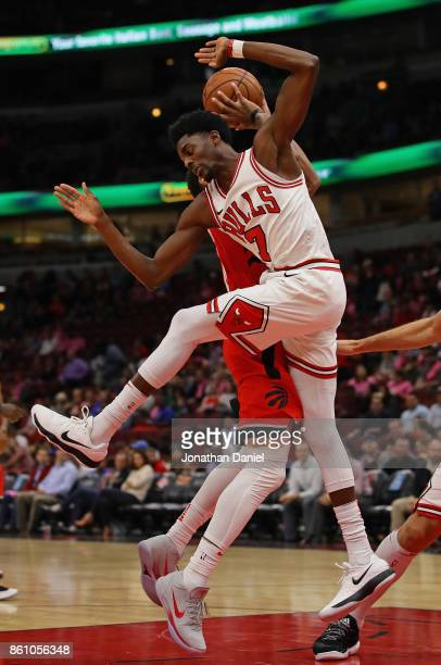 Justin Holiday of the Chicago Bulls fouls DeMar DeRozan of the Toronto Raptors during a preseason game at the United Center on October 13 2017 in...