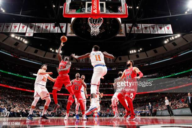 Justin Holiday of the Chicago Bulls goes to the basket against the New York Knicks on December 9 2017 at the United Center in Chicago Illinois NOTE...