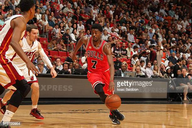 Justin Holiday of the Chicago Bulls handles the ball against the Miami Heat on April 7 2016 at AmericanAirlines Arena in Miami Florida NOTE TO USER...