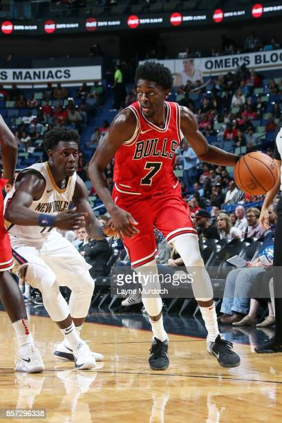 Justin Holiday of the Chicago Bulls handles the ball during a preseason game against the New Orleans Pelicans on October 3 2017 at the Smoothie King...