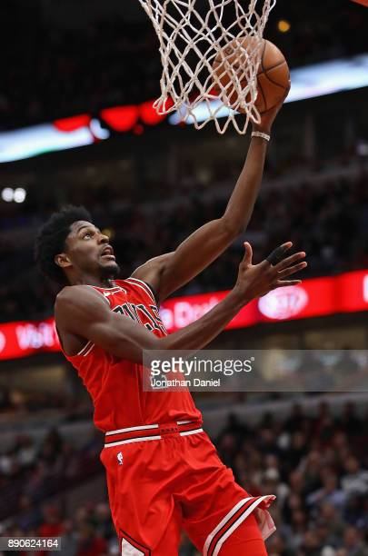 Justin Holiday of the Chicago Bulls lays in a shot against the Boston Celtics at the United Center on December 11 2017 in Chicago Illinois NOTE TO...