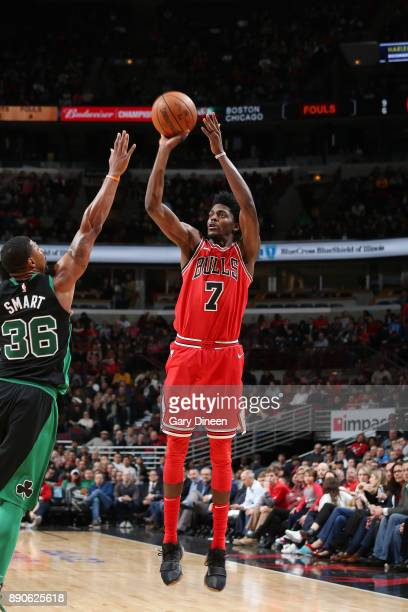 Justin Holiday of the Chicago Bulls shoots the ball against the Boston Celtics on December 11 2017 at the United Center in Chicago Illinois NOTE TO...