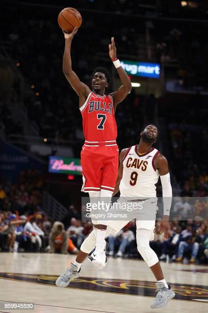 Justin Holiday of the Chicago Bulls takes a first half shot next to Dwyane Wade of the Cleveland Cavaliers during a pre season game at Quicken Loans...