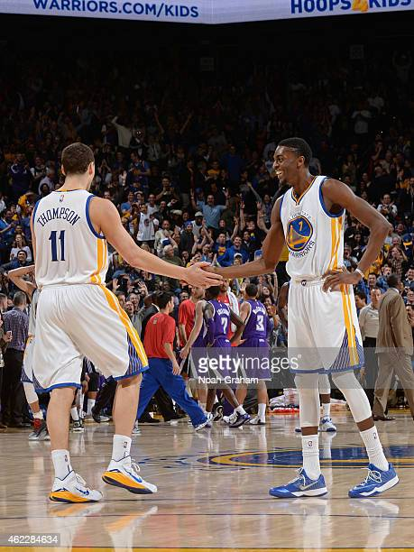 Justin Holiday of the Golden State Warriors congratulates Klay Thompson after setting a NBA record with 37 points in a quarter against the Sacramento...