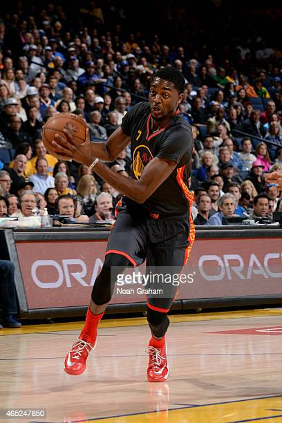 Justin Holiday of the Golden State Warriors drives against the Milwaukee Bucks on March 4 2015 at Oracle Arena in Oakland California NOTE TO USER...