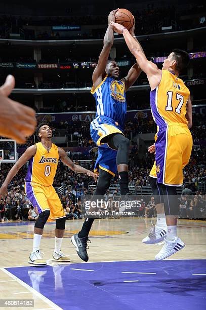 Justin Holiday of the Golden State Warriors goes to the basket against Jeremy Lin of the Los Angeles Lakers on December 23 2014 at Staples Center in...