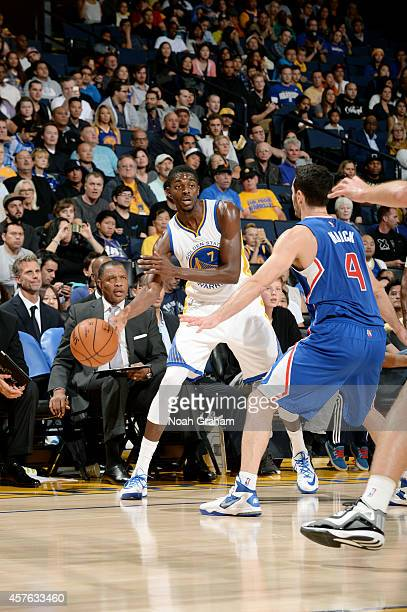 Justin Holiday of the Golden State Warriors passes against the Los Angeles Clippers on October 21 2014 at Oracle Arena in Oakland California NOTE TO...