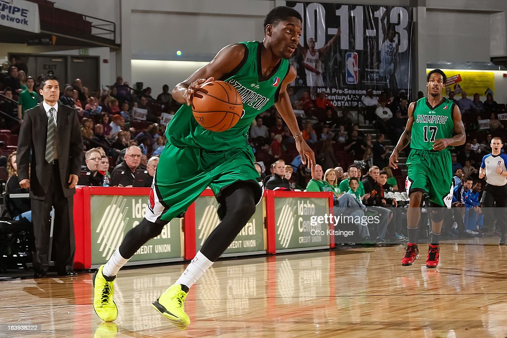 Justin Holiday #12 of the Idaho Stampede brings the ball up court against the Tulsa 66ers during an NBA D-League game on March 16, 2013 at CenturyLink Arena in Boise, Idaho. The Stampede wore green jerseys for a St. Patrick's Day-related fundraiser.
