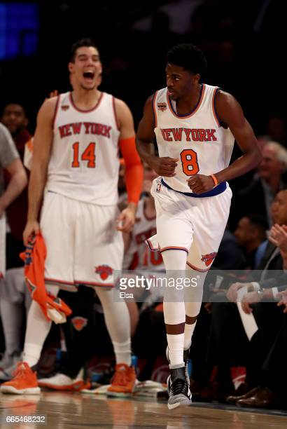 Justin Holiday of the New York Knicks celebrates his threepoint shot in the first half against the Washington Wizards as teamamte Willy Hernangomez...