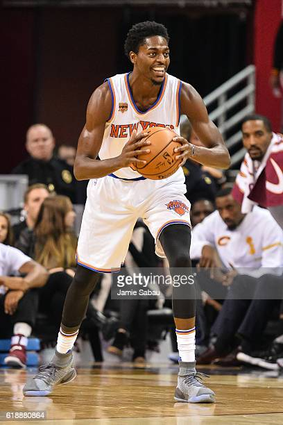 Justin Holiday of the New York Knicks controls the ball against the Cleveland Cavaliers on October 25 2016 at Quicken Loans Arena in Cleveland Ohio...