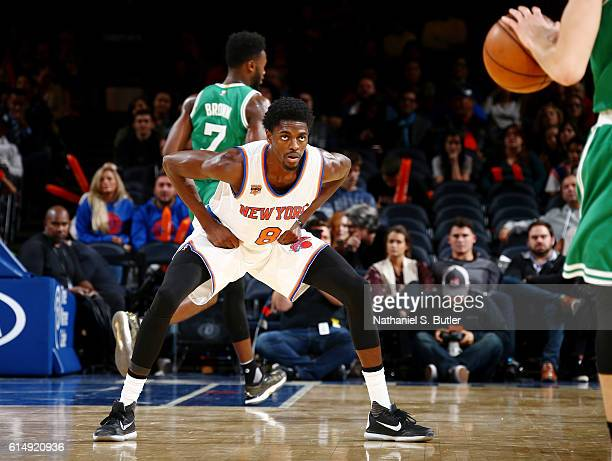 Justin Holiday of the New York Knicks defends against the Boston Celtics on October 15 2016 at Madison Square Garden in New York City New York NOTE...