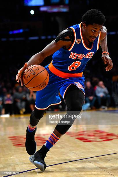 Justin Holiday of the New York Knicks dribbles the ball during the game against the Los Angeles Lakers on December 11 2016 at STAPLES Center in Los...