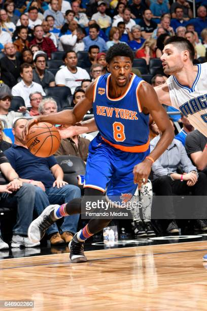 Justin Holiday of the New York Knicks handles the ball during a game against the Orlando Magic on March 1 2017 at Amway Center in Orlando Florida...
