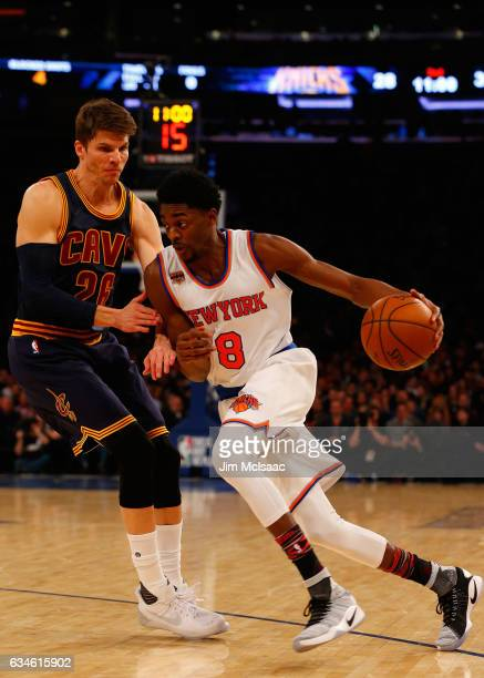 Justin Holiday of the New York Knicks in action against Kyle Korver of the Cleveland Cavaliers at Madison Square Garden on February 4 2017 in New...