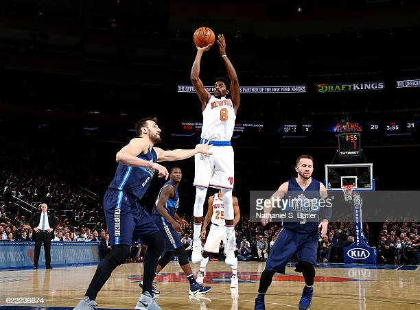 Justin Holiday of the New York Knicks shoots the ball against the Dallas Mavericks during the game on November 14 2016 at Madison Square Garden in...