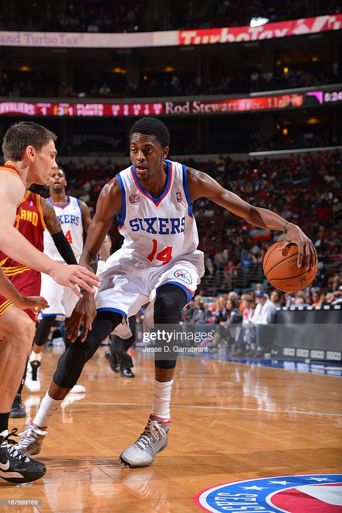 Justin Holiday #14 of the Philadelphia 76ers looks to pass the ball against the Cleveland Cavaliers at the Wells Fargo Center on April 14, 2013 in Philadelphia, Pennsylvania.