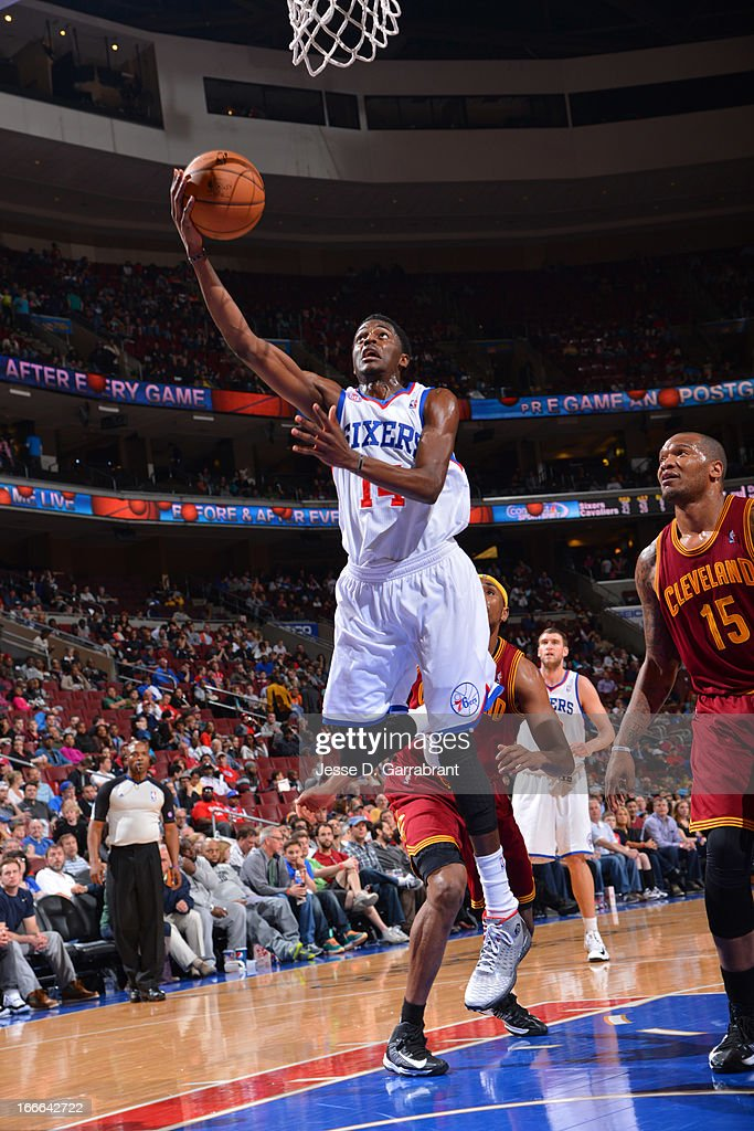 Justin Holiday #14 of the Philadelphia 76ers shoots a layup against the Cleveland Cavaliers at the Wells Fargo Center on April 14, 2013 in Philadelphia, Pennsylvania.