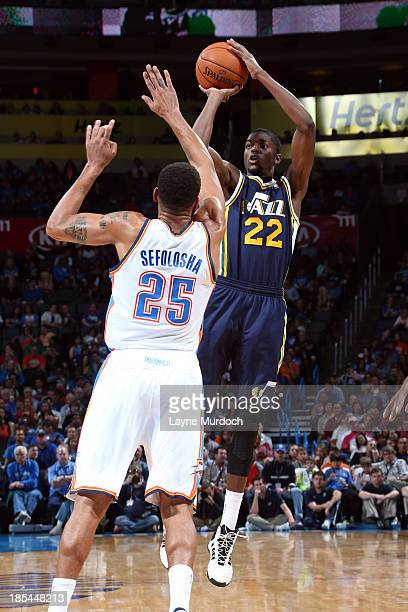 Justin Holiday of the Utah Jazz shoots the ball against the Oklahoma City Thunder during an NBA preseason game on October 20 2013 at the Chesapeake...