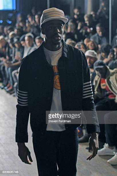 Justin Holiday walks the runway for Grungy Gentleman Front Row NYFW Men's on February 2 2017 in New York City
