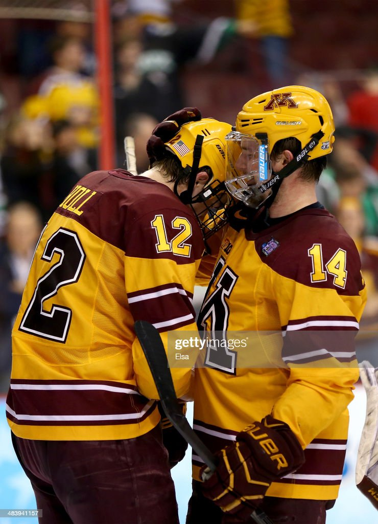 Justin Holl #12 of the Minnesota Golden Gophers is congratulated by teammate Tom Serratore #14 after the game against the North Dakota Fighting Sioux during the 2014 NCAA Division I Men's Hockey Championship Semifinal at Wells Fargo Center on April 10, 2014 in Philadelphia, Pennsylvania.The Gophers defeated the Fighting Sioux 2-1 with Holl's goal as the game winner.