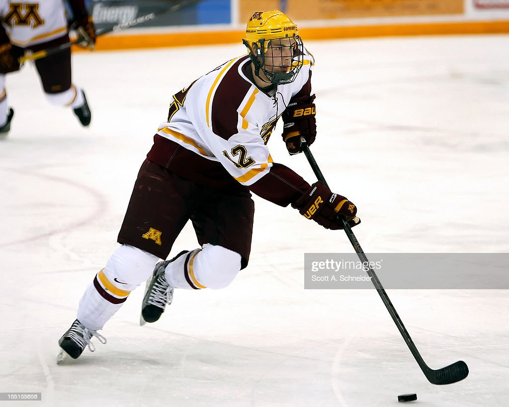 Justin Holl #12 of the University of Minnesota carries the puck in a game against the United States U-18 team October 26, 2012 at Mariucci Arena in Minneapolis, Minnesota.