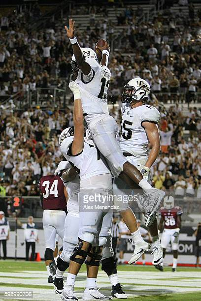 Justin Holman of the UCF Knights celebrates a touchdown during a NCAA football game against the South Carolina State Bulldogs at Bright House...